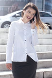 Elegant young businesswoman talking by phone. Royalty Free Stock Photos