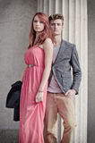 Elegant young couple next to old stone column Royalty Free Stock Photo