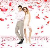 Elegant young couple in the petal rain Royalty Free Stock Image