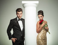 Elegant young couple posing near column Royalty Free Stock Photo