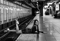 Elegant young fashion model posing at NYC subway. Royalty Free Stock Photo