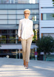 Elegant young fashion woman walking outside Stock Photo
