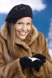 Elegant young female enjoying winter snow smiling Royalty Free Stock Photos