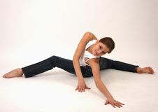 Elegant young flexible woman Royalty Free Stock Photos