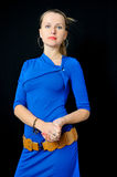 Elegant young girl in blue dress Stock Images