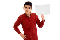 Elegant young guy in red shirt with empty placard in hands posing isolated on white background Stock Image
