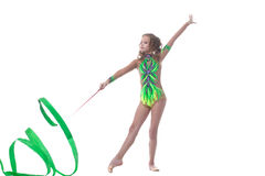 Elegant young gymnast dancing with ribbon Stock Photo