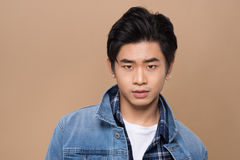 Elegant young handsome asian man. Cool fashion male model. Royalty Free Stock Images