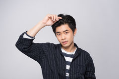 Elegant young handsome asian man. Cool fashion male model. Royalty Free Stock Photography