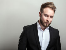 Elegant young handsome bearded man in classic black costume & white shirt.  Royalty Free Stock Photos
