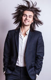 Elegant young handsome long-haired man in costume. Royalty Free Stock Photo