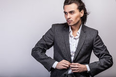 Elegant young handsome long-haired man in costume. Royalty Free Stock Photos