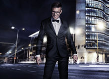 Elegant young handsome man. Over night city background Royalty Free Stock Photo