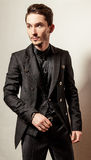 Elegant young handsome man in black costume. Studio fashion portrait. Stock Photos