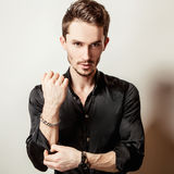 Elegant young handsome man in black silk shirt. Studio fashion portrait. Royalty Free Stock Photos