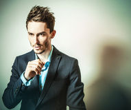 Elegant young handsome man in classic costume. Studio fashion portrait. Stock Images