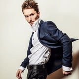 Elegant young handsome man in classic costume. Studio fashion portrait. Royalty Free Stock Photos