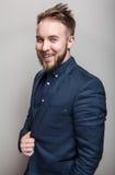 Elegant young handsome man in classic dark blue costume. Studio fashion portrait. stock photography
