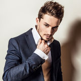 Elegant young handsome man in costume. Studio fashion portrait. Royalty Free Stock Image