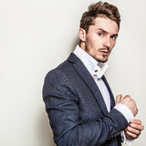 Elegant young handsome man in costume. Studio fashion portrait. royalty free stock photo