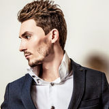 Elegant young handsome man in costume. Studio fashion portrait. Royalty Free Stock Images