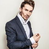 Elegant young handsome man in costume. Studio fashion portrait. Stock Images