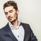 Elegant young handsome man in costume. Studio fashion portrait. Royalty Free Stock Photography
