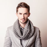 Elegant young handsome man in grey costume. Studio fashion portrait. Royalty Free Stock Photography