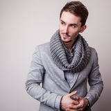 Elegant young handsome man in grey costume. Studio fashion portrait. Stock Images