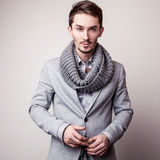 Elegant young handsome man in grey costume. Studio fashion portrait. Stock Photography