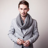 Elegant young handsome man in grey costume. Studio fashion portrait. Royalty Free Stock Photo