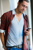 Elegant young handsome man with mobile phone. Stock Photo