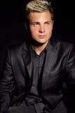 Elegant young handsome man over dark. Studio fashion portrait. Stock Images