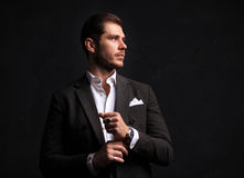 Elegant young handsome man. Studio fashion portrait Stock Photos