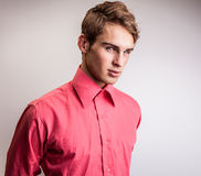 Elegant young handsome man. Studio fashion portrait on bright background. Royalty Free Stock Photos
