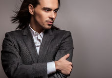 Elegant young handsome man. Studio fashion portrait. Photo royalty free stock image