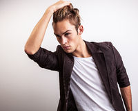 Elegant young handsome man. Studio fashion portrait. Royalty Free Stock Images