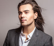 Elegant young handsome man. Studio fashion portrait. Royalty Free Stock Photography