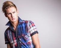 Elegant young handsome man. Studio fashion portrait. Royalty Free Stock Images