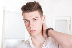 Elegant young handsome man in white shirt Royalty Free Stock Photography