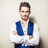 Elegant young handsome man in white shirt & vest. Studio fashion portrait. Royalty Free Stock Images