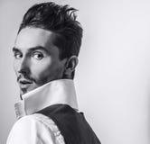 Elegant young handsome man in white shirt & vest. Studio fashion portrait. Royalty Free Stock Image