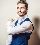 Elegant young handsome man in white shirt & vest. Studio fashion portrait. Stock Images