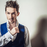 Elegant young handsome man in white shirt & vest. Studio fashion portrait. Royalty Free Stock Photos
