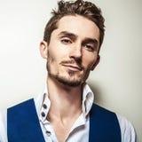Elegant young handsome man in white shirt & vest. Studio fashion portrait. Royalty Free Stock Photos