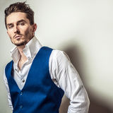 Elegant young handsome man in white shirt & vest. Studio fashion portrait. Stock Image