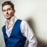 Elegant young handsome man in white shirt & vest. Studio fashion portrait. Elegant young handsome man in white shirt & vest Stock Image