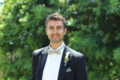 Elegant young happy groom in tuxedo.  Royalty Free Stock Images