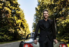 Elegant young happy man in convertible car outdoor. Royalty Free Stock Photos