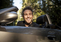 Elegant young happy man in convertible car outdoor. Royalty Free Stock Photography